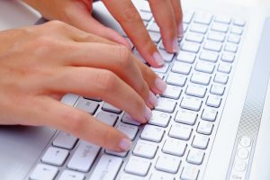 fingers-typing-on-laptop-keyboard